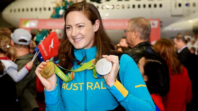 Cate Campbell with her Rio medal after arriving home. Picture: Mark Evans