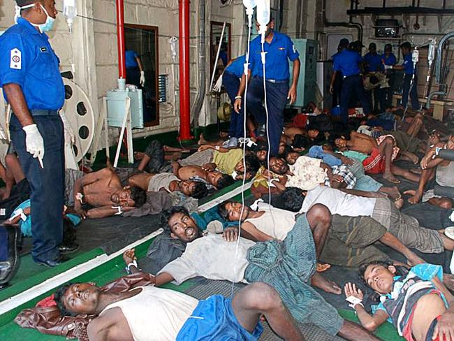 Curtailed ... a file photo from February, 2013 shows Myanmar nationals rescued off Sri Lanka's eastern coast whose wooden vessel began sinking while making a perilous journey to Australia. Picture: Sri Lanka Navy