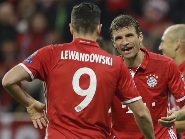 Bayern's Thomas Mueller, right, celebrates with his teammate Bayern's Robert Lewandowski.