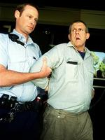 Bradley John Murdoch is arrested outside a South Australian court on 10 November 2003, for the killing of Peter Falconio in NT on 14 Jul 2001. Picture: Newsltd library