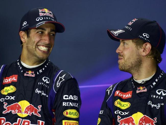 Daniel Ricciardo (L) has enjoyed a breakout year for Red Bull Racing while team mate Sebastian Vettel (R) has struggled.