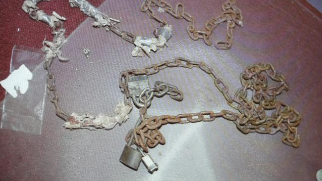 Chains found in an upstairs bedroom. (AP Photo/Tony Dejak)
