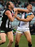 Round 19: Alipate Carlile cops a high fend-off from Collingwood's Travis Cloke. Picture: George Salpigtidis