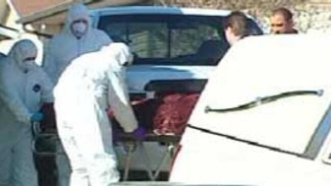 Paramedics remove the bodies from the house where the murder scene traumatised detectives for years to come. Picture: CBC