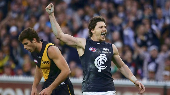 Carlton's Nick Duigan celebrates a final-quarter goal as the Blues stormed home.