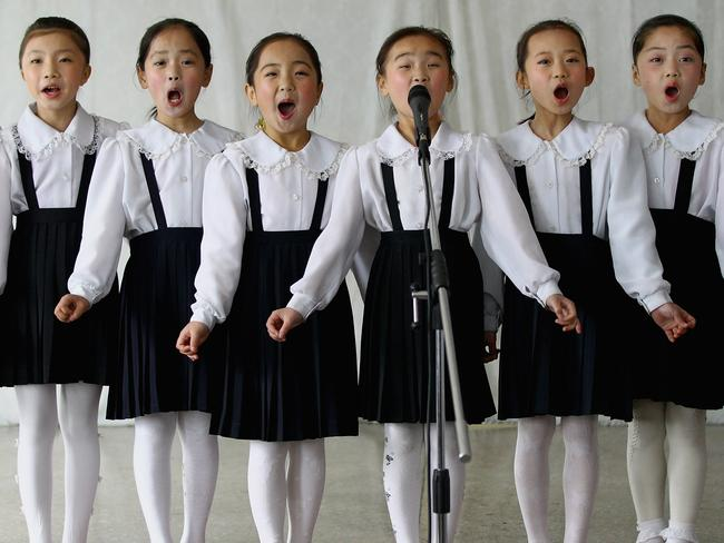 North Korean children perform in a primary school in Pyongyang, North Korea. Picture: Getty