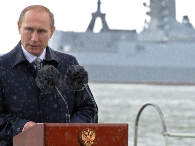 Russian President Vladimir Putin delivers a speech under the rain during celebrations for Navy Day in Baltiysk in Kaliningrad. The purge of naval officers from the Baltic Sea fleet has been linked to Putin's dismissal of the chief of his navy last year. Picture: AFP