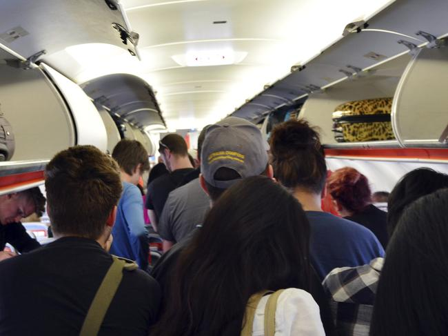 Melbourne, Australia - April 10, 2014: Interior of airplane with passengers get on board. According to Us Travel Association, the average age of leisure travelers is 47. 5 years old.