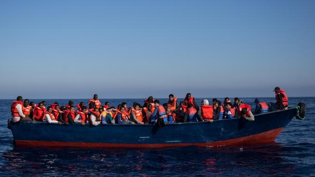 Refugees and migrants wait to be rescued from an overcrowded boat. Pic: Getty