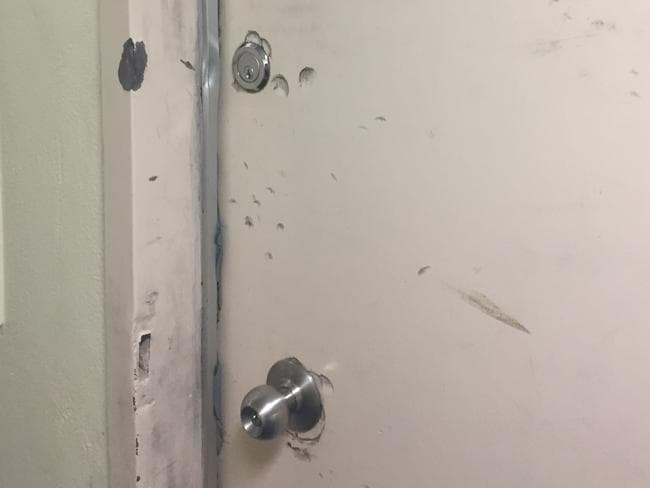 Many doors show signs of break-ins, damage and neglect. Some units have been boarded up.