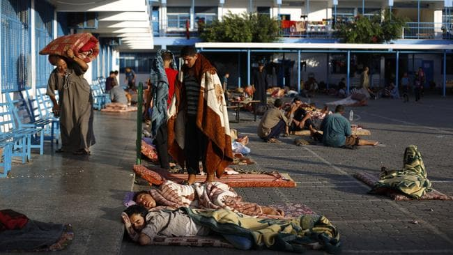 Displaced Palestinians sleep at a United Nations school in Beit Lahia in the northern Gaza strip, where they are taking refuge after fleeing their homes.