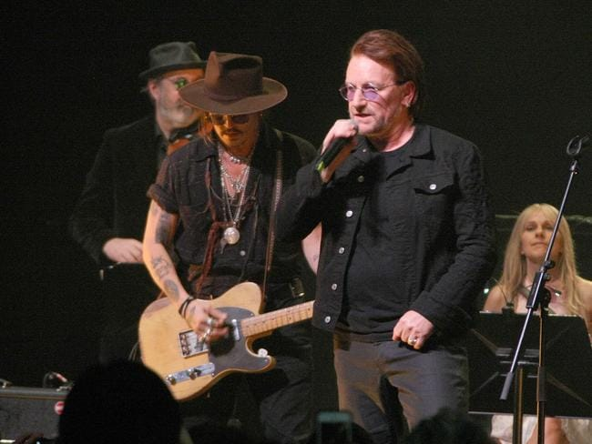 Irish superstar Bono paid tribute to the late Dolores O'Riordan while performing in Dublin with Johnny Depp. Picture: Splash News