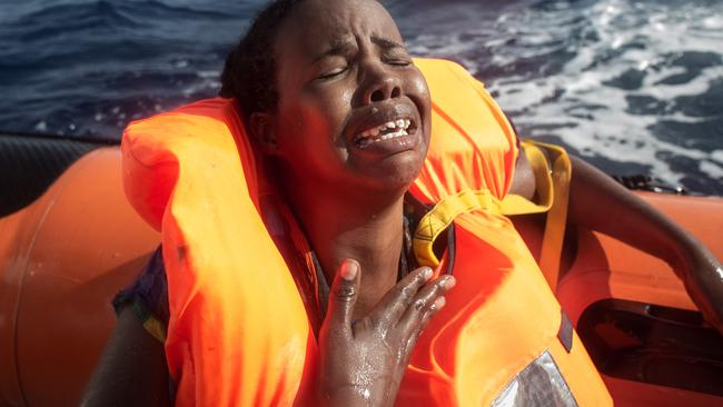 A woman cries after losing her baby in the water. Pic: Getty