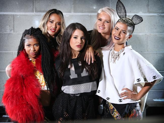 Simone Battle, left, backstage at The X Factor studios in Moore Park, Sydney, with the other members of American girl group GRL. Picture: Richard Dobson