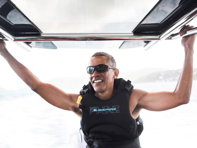 Mr Obama takes a break from learning to kitesurf at Richard Branson's Necker Island retreat in the British Virgin Islands in February. Picture: Jack Brockway/Getty Images