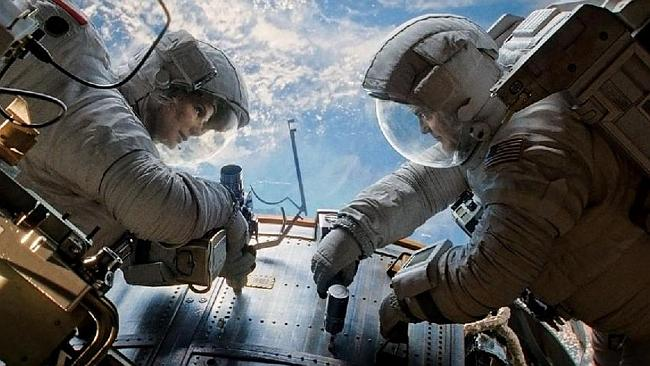 Sandra Bullock and George Clooney in a scene from the disaster film Gravity. Picture: Supplied