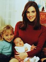 <p>Jordan's Queen Rania, the Palestinian-born wife of King Abdullah II, holds her three-month-old baby girl, Princess Salma, watched on by Princess Iman, 4, at their al-Barakeh, or Blessing, Palace on the outskirts of the Jordanian capital Amman. The photo, taken in November 2000 was the first public appearance of the queen with her newborn baby girl. Picture: AP</p>