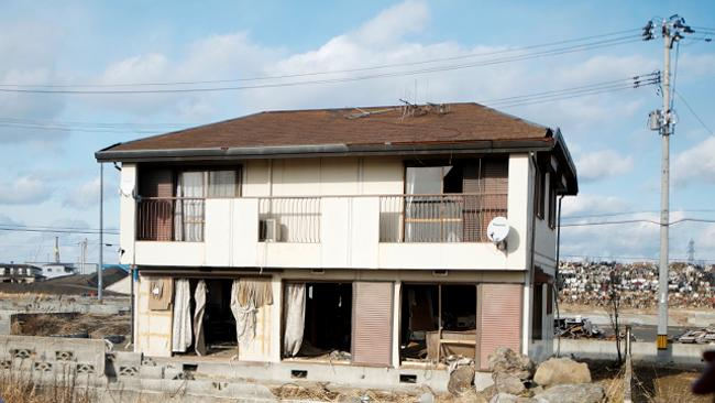 A damaged house in Natori sits abandoned, waiting for demolition. Picture: Helen Davidson