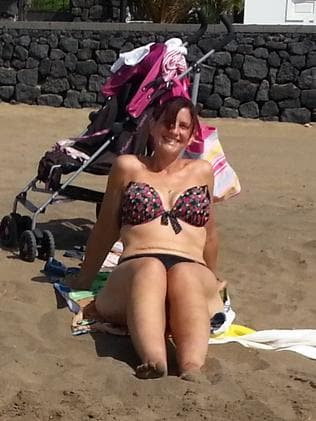 Donna on the beach in a bikini, having lost a whopping 70kg. Photo: Austral Scope