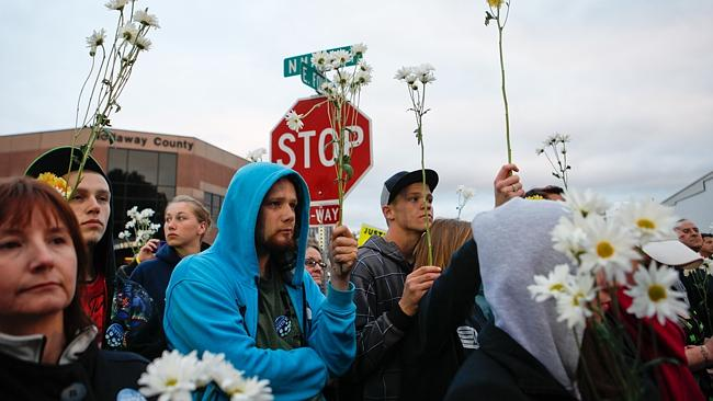 Protesters hold daisies at the Justice for Daisy rally in Maryville.