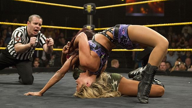 "Performer Emma (Tenille Dashwood) stretches her opponent in the ""Emma Lock""."