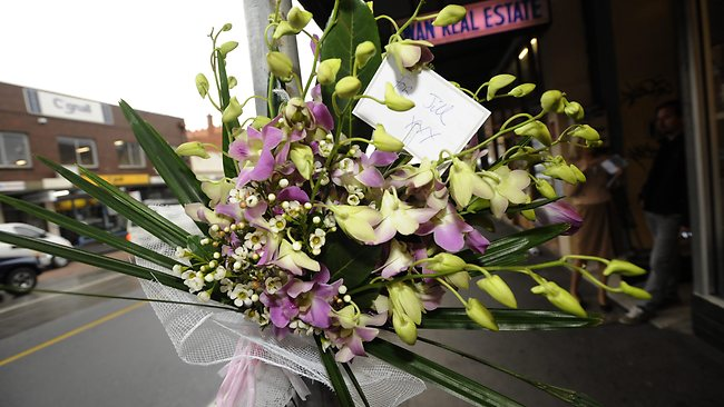 A simple tribute to Jill Meagher is left with flowers outside the Duchess Boutique on Sydney Rd. Picture: Robert Mckechnie