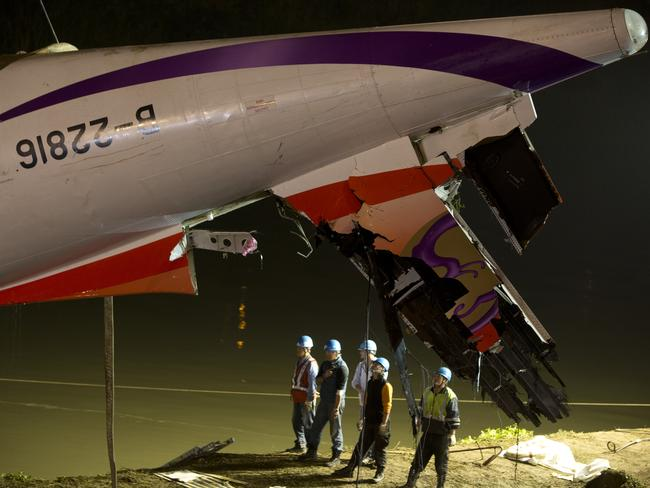 The passenger plane, operated by TransAsia Airways, clipped an overpass soon after take-off and plunged into a river in Taiwan, the airline's second crash in seven months. Picture: Ashley Pon