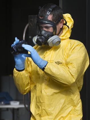 A chemical operations team member documents evidence.