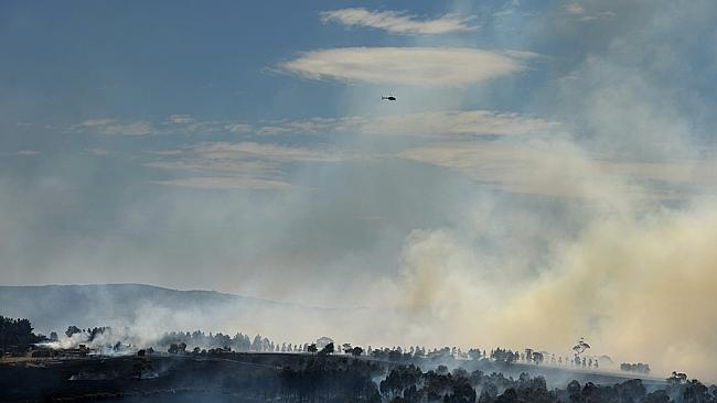 Helicopters flying into affected areas came up against a wall of smoke. Picture: Jake Nowakowski. .