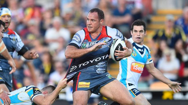 An intimidating Matt Scott makes a charge up the field against the Titans.