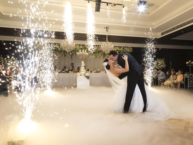 The couple share a kiss during their first official dance as husband and wife.