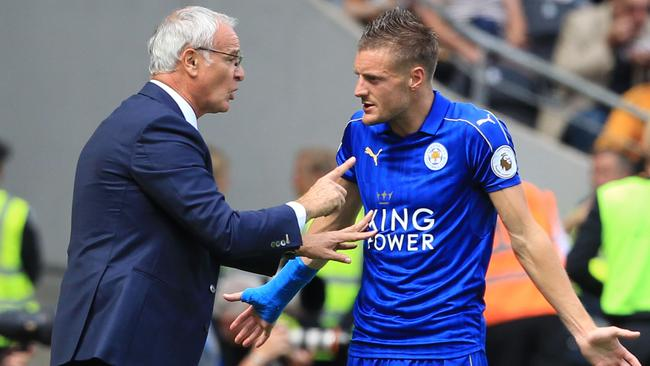 (FILES) This file photo taken on August 13, 2016 shows Leicester City's Italian manager Claudio Ranieri (L) gesturing as he talks with Leicester City's English striker Jamie Vardy (R) on the touchline during the English Premier League football match between Hull City and Leicester City at the KCOM Stadium in Kingston upon Hull, north east England on August 13, 2016. Premier League champions Leicester City have sacked manager Claudio Ranieri, the club announced in a statement on February 23, 2017. / AFP PHOTO / Lindsey PARNABY / RESTRICTED TO EDITORIAL USE. No use with unauthorized audio, video, data, fixture lists, club/league logos or 'live' services. Online in-match use limited to 75 images, no video emulation. No use in betting, games or single club/league/player publications. /