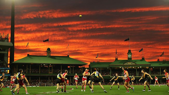 Sydney's Shane Mumford takes the tap during a dramatic sunset in the second quarter of AFL match between Sydney Swans v Richmond Tigers at the SCG. Picture: Hillyard Philip