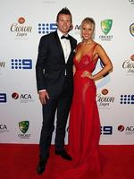 Peter Siddle and partner Anna Weatherlake on the red carpet of the 2014 Allan Border medal. Pic Brett Costello