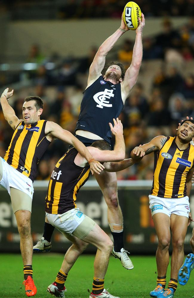 Sam Rowe rises between three Hawks to mark strongly. Picture: Getty
