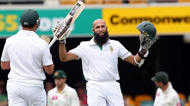 Hashim Amla scores his ton and raises his bat to the crowd at the Gabba. Picture: Adam Head.