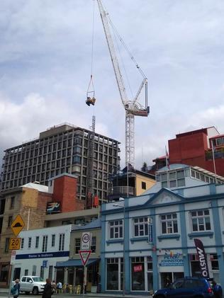 A Mercury reader took this picture of heavy equipment being craned to the top of 10 Murray St as part of the long-awaited demolition process.