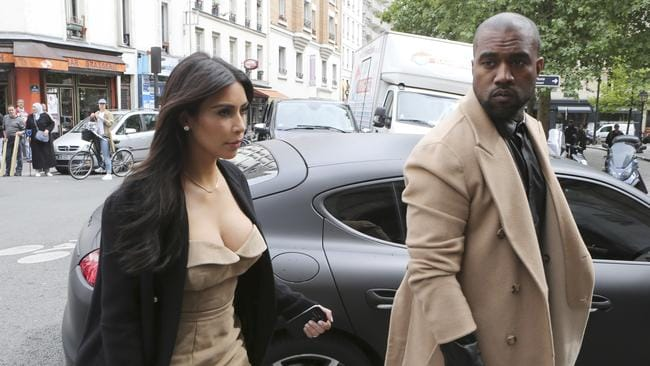 Loved up ... Kim Kardashian and Kanye West are in Paris ahead of their weekend wedding ceremony. Picture: AP