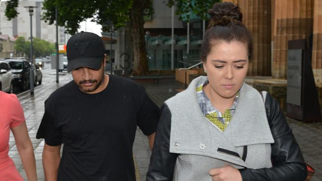 Kyle Jones leaves the Adelaide Magistrates Court on Wednesday with AFL player Patrick Ryder's wife Jessica. Picture: AAP/Brenton Edwards