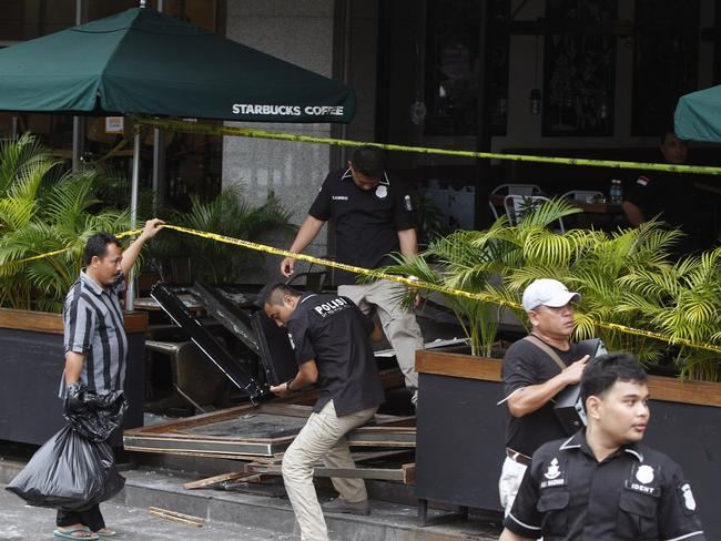 Indonesian forensic police ... inspect the scene of a bomb blast at a Starbucks coffee store in Jakarta. Picture: AAP