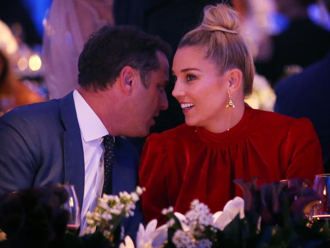 Stefanovic whispers into his girlfriend's ear as they watch on at the David Jones Spring/Summer fashion parade.