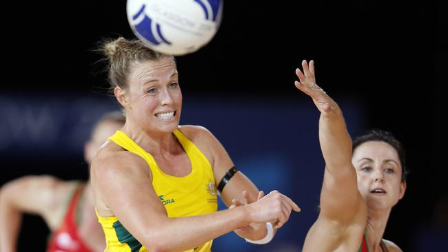 Australia's Kimberlee Green, left, in action against Wales.