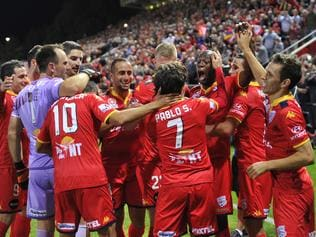 United players celebrate win during the A-League semi-final between Adelaide United and Melbourne City at Coopers Stadium in Adelaide, Friday, April 22, 2016. (AAP Image/David Mariuz) NO ARCHIVING, EDITORIAL USE ONLY