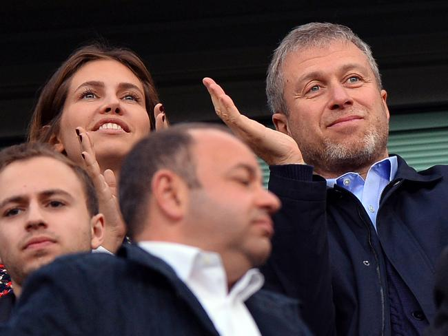 Roman Abramovich (R) applauding next to partner Dasha Zhukova (L) during the English Premier League football match between Chelsea and Arsenal at Stamford Bridge in London. Picture: AFP PHOTO / Ben STANSALL