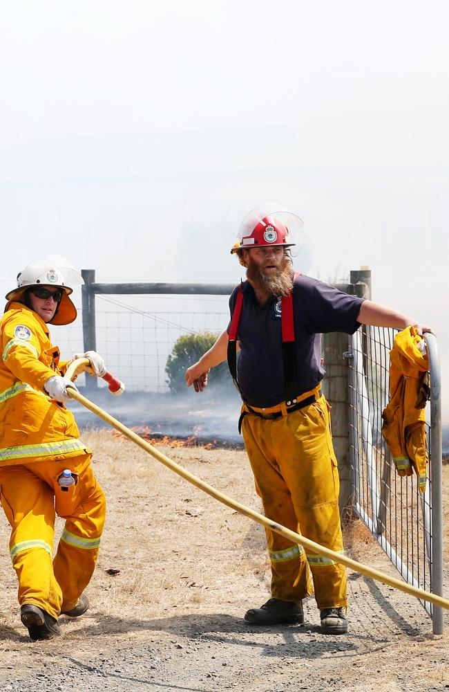 Firefighters work hard to save property around Wallan and Kilmore. Picture: Ian Currie.