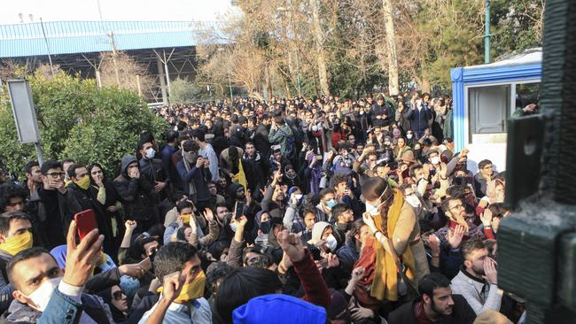 University students attend a protest inside Tehran University while anti-riot Iranian police prevent them to join other protesters. Picture: AP Photo