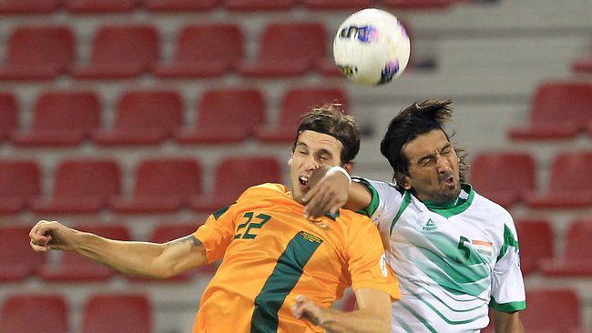 WORLD Cup football qualifier, Iraq v Australia in Doha, Qatar. Australia won 2-1: Matthew Spiranovic of Australia competes with Nashat Akram of Iraq. Picture: Fadi Al-Assaad