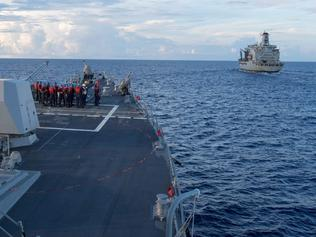 """This handout photo taken on May 19, 2017 and received from the US Navy on May 25, 2017 shows the Arleigh Burke-class guided-missile destroyer USS Dewey (L) preparing for a replenishment-at-sea with the Henry J. Kaiser-class fleet replenishment oiler USNS Pecos (R) in the South China Sea. The US warship USS Dewey sailed near a reef claimed by Beijing in the South China Sea on May 25, 2017, a US official said, the first such operation by US President Donald Trump's administration in the disputed waterway. The Chinese government charged later on May 25 that the US warship had entered its waters in the South China Sea """"without permission"""", prompting China's navy to warn the vessel to leave. / AFP PHOTO / US NAVY / Kryzentia Weiermann / -----EDITORS NOTE --- RESTRICTED TO EDITORIAL USE - MANDATORY CREDIT """"AFP PHOTO / US NAVY / Mass Communication Specialist 3rd Class Kryzentia Weiermann"""" - NO MARKETING - NO ADVERTISING CAMPAIGNS - DISTRIBUTED AS A SERVICE TO CLIENTS"""