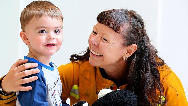 Royal Children's Hospital Appeal poster boy Riley Twomey with CFA member Jenna Kelley.