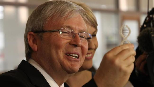 Kevin Rudd, with Health Minister Tanya Plibersek, holds a model of a double helix during a press conference while announcing a new medical research package in Wooloongabba, Brisbane.